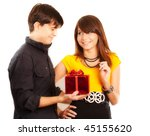 man give gift to girl, girl smiling - stock photo