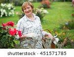 Smiling Senior Woman Gardener...