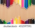 color pencils on wooden table... | Shutterstock . vector #451597591