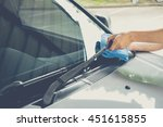 cleaning a windshield wiper... | Shutterstock . vector #451615855