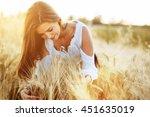 beautiful woman hugging barley... | Shutterstock . vector #451635019