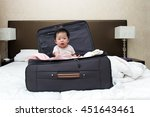 Asian Baby Sitting In Travel...