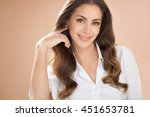 smiling woman with long brown... | Shutterstock . vector #451653781