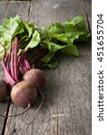 young fresh beets with tops on... | Shutterstock . vector #451655704