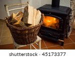 Basket Of Logs In Front A...