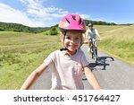 portrait of little girl riding... | Shutterstock . vector #451764427