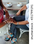 Small photo of Mother and daughter women holding hands affectionate in a cafe
