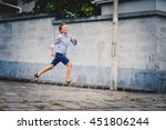 Boy Running In The Street.