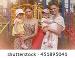 two mothers holds children ... | Shutterstock . vector #451895041