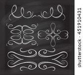 Set of elegant white flourishes for your design on the chalkboard.