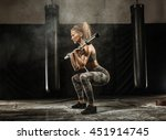 sporty girl squats with barbell ... | Shutterstock . vector #451914745