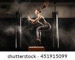 sporty girl jumping over some... | Shutterstock . vector #451915099