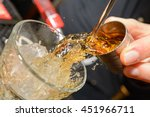 whiskey shot mid pour | Shutterstock . vector #451966711