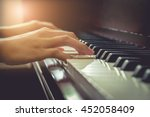 Musician Playing Piano In...
