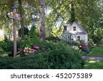 a charming playhouse sits at... | Shutterstock . vector #452075389