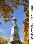 Small photo of Monument and Autumn colors at the Charles River bank on Harvard University campus in Cambridge, MA, USA