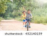 young asian boy ride a blue... | Shutterstock . vector #452140159