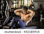 man sit ups in gym. | Shutterstock . vector #452185915