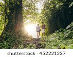 Young Man And Woman Hiking In...