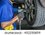 mechanician changing car wheel... | Shutterstock . vector #452250859