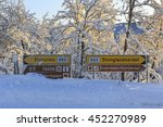 road sign on a snowy road on... | Shutterstock . vector #452270989