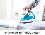 closeup of woman ironing... | Shutterstock . vector #452289064