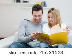 young couple reading together a ... | Shutterstock . vector #45231523
