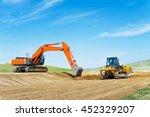 Excavator And Bulldozer On Road ...
