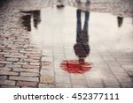 rainy day. reflection of young... | Shutterstock . vector #452377111