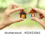 toy ceramic houses in hand   | Shutterstock . vector #452421061