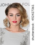 Small photo of Hollywood, CA, USA; February 26, 2012; Miley Cyrus arrives to the 20th Annual Elton John AIDS Foundation Academy Awards Viewing Party.