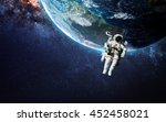 astronaut in outer space.... | Shutterstock . vector #452458021