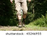 Legs With Hiking Boots Of A...