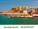 Old harbour of Chania with Venetian quay and Kucuk Hasan Pasha Mosque in the sunny morning, Crete, Greece