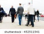 crowd of commuters walking in... | Shutterstock . vector #452511541