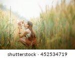 cute dreamy girl on golden ripe ... | Shutterstock . vector #452534719