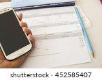 hand holding mobile phone...   Shutterstock . vector #452585407