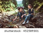 a couple of tourists hiking... | Shutterstock . vector #452589301