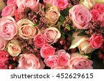 Stock photo pastel roses in different shades of pink in a bridal arrangement 452629615