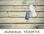 water bottle with phone on wood ... | Shutterstock . vector #452634715