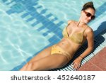 woman sunbathing by the pool in ... | Shutterstock . vector #452640187