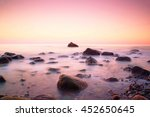 Pink Sunset At Rocky Coast Of...