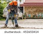 Workers Use Concrete Breaker...