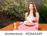 woman smiling and having lunch... | Shutterstock . vector #452661649