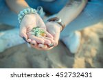 Sea Glass Pieces In The Hands...