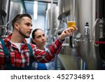 Small photo of Brewers testing beer at brewery