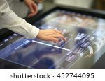 scientist clicking on a large... | Shutterstock . vector #452744095