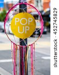 Small photo of Pop up spirit catcher sign on post