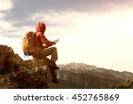 successful woman backpacker use ... | Shutterstock . vector #452765869