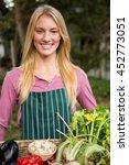 portrait of happy young female...   Shutterstock . vector #452773051